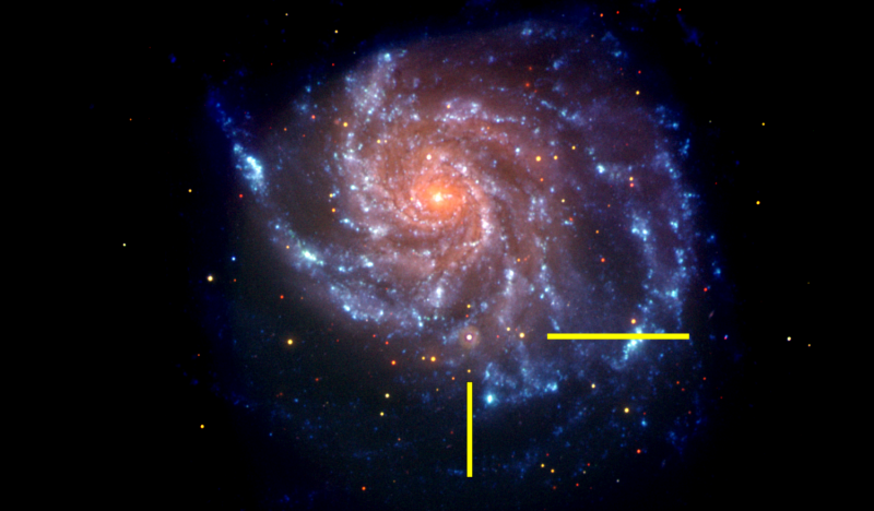 That same galaxy in a NASA Swift image is shown, with bars indicating the location of supernova SN 2011fe. The Swift image is a false-color image with UV emission blue and optical emission red. Credit: NASA/Swift