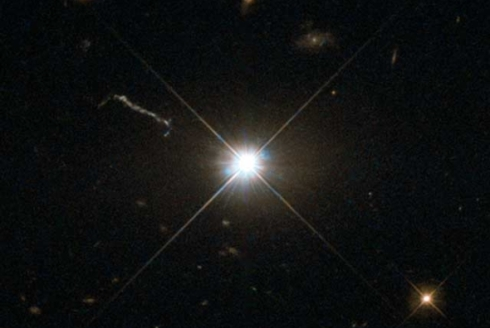 The quasar 3C 273, which resides in a giant elliptical galaxy in the constellation of Virgo.