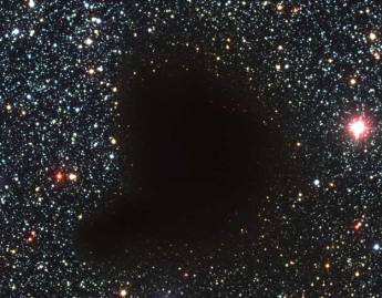 Figure 1: Molecular Cloud Barnard 68: A small molecular cloud, or Bok globule, of about 2 solar masses, at a distance of about 500 light-years, and about ½ light-year across, yet not a single star can be seen in it. That means there are no stars between the sun and the cloud. It absorbs all light from the background stars, hence is optically thick. (Illustrated on page 409 of Carroll & Ostlie, 2nd Edition) Credit: FORS Team, 8.2-meter VLT Antu, ESO